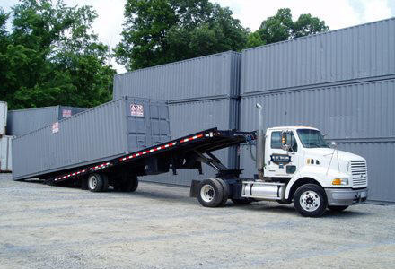 All Bay Trucking Tilt Bed Ground Delivery of Shipping and Storage